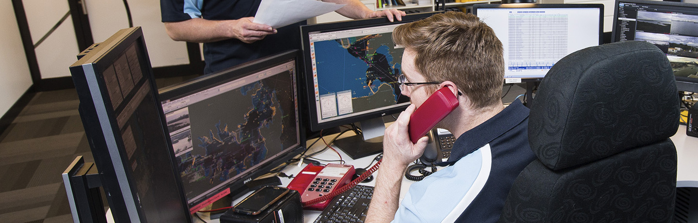 Port Authority employee answering a phone call