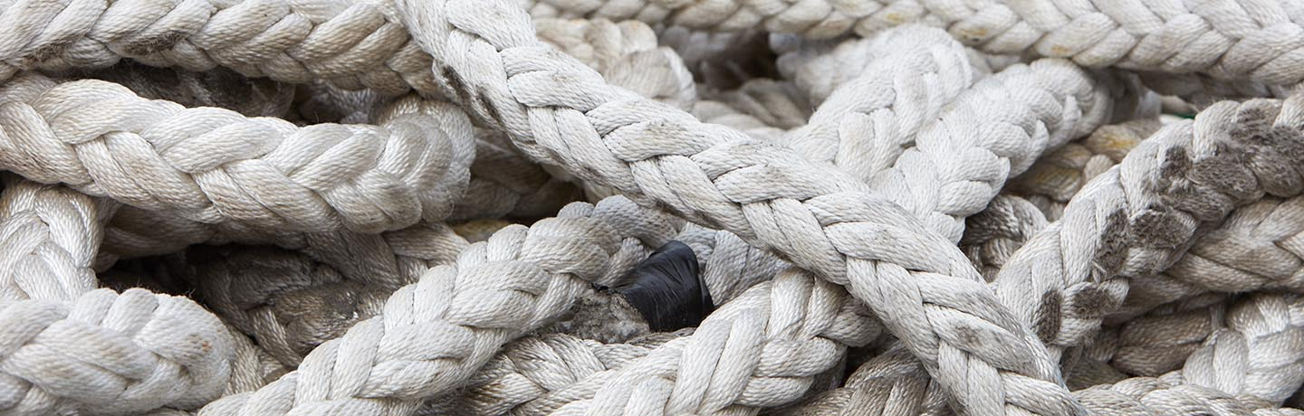 A pile of intertwining nautical ropes