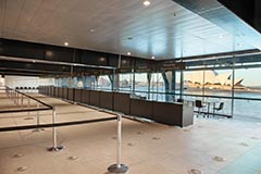 Inside of the OPT showing counters for cruise ship check in