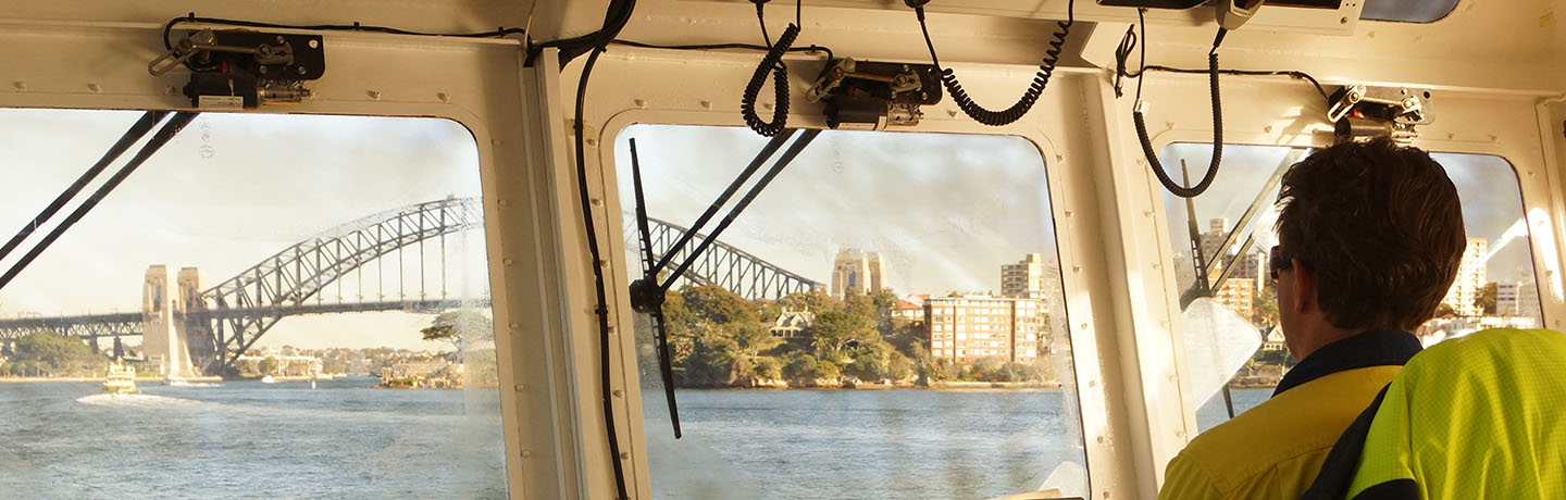 Port Authority employee piloting a vessel in Sydney Harbour