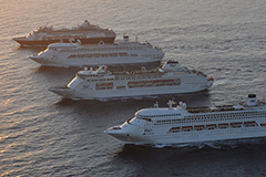 Four cruise ships in a row out at sea