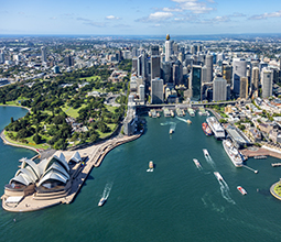 Aerial shot of Sydney harbour with ships entering and exiting