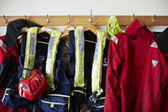 Life jackets hung up on hanging rack