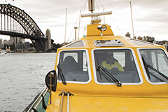 Pilot vessel in front of OPT with Harbour bridge in the background