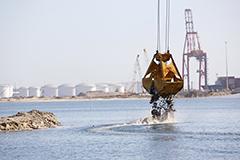 Crane picking up sediment at Port Botany