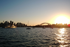 Vessel out on Sydney Harbour at sunset