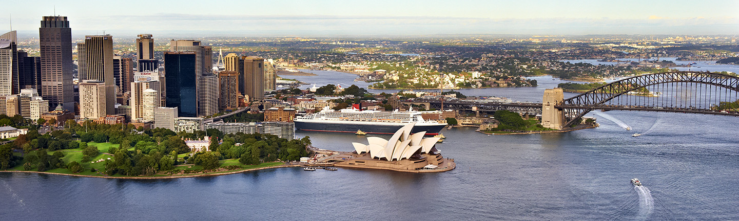 Aerial shot of Sydney Harbour with skyline, opera house and part of the bridge in view